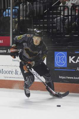 Katie Fyfe | The Journal Gazette  Komets defenseman Kyle Hass carries the puck during the first period against the Toledo Walleye at Memorial Coliseum on Saturday.