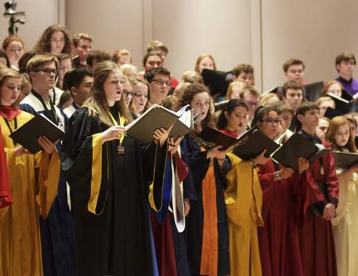 Katie Fyfe | The Journal Gazette The All-State Honor Choir rehearses Saturdayfor its Indiana Music Education Association's Professional Development Conference show.