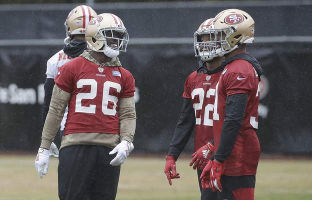 Associated Press San Francisco 49ers running back Tevin Coleman, left, laughs with teammates Thursday at the team's training facility in Santa Clara, Calif.