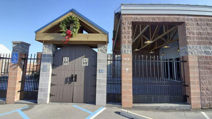 The gated entrance to Three Rivers Distilling Co. on Wallace St.