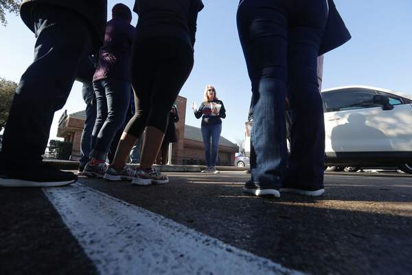 Democratic Precinct Chair Monica Shevell speaks to volunteers before a for a voter registration drive in Richardson, Texas, Saturday, Jan. 18, 2020. (AP Photo/LM Otero)
