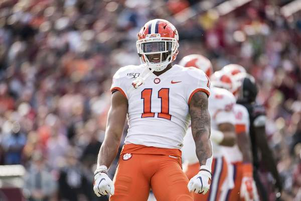 FILE - In this Nov. 30, 2019, file photo, Clemson linebacker Isaiah Simmons (11) celebrates a stop against South Carolina during an NCAA college football game, in Columbia, S.C. (AP Photo/Sean Rayford, File)