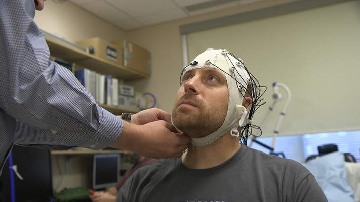 Associated Press  Zach Ault, who suffers from chronic fatigue, is fitted with an EEG cap at the National Institutes of Health's hospital in Bethesda, Md.