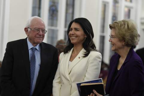 MLK Day South Carolina US. Sen. Bernie Sanders, left, I-Vt., U.S. Rep. Tulsi Gabbard, center, D-Hawaii, and Sen. Elizabeth Warren, right, D--Mass., speak at a Martin Luther King Jr. Day services at Zion Baptist Church, Monday, Jan. 20, 2020, in Columbia, S.C. (AP Photo/Meg Kinnard) (Meg Kinnard