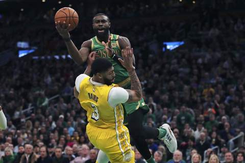 Lakers Celtics Basketball Associated Press Celtics guard Jaylen Brown drives to the basket against Lakers forward Anthony Davis during the first half Monday night in Boston. (Charles KrupaSTF)