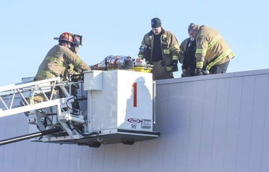 Michelle Davies | The Journal Gazette Fort Wayne firefighters rescue a man from the J.C. Penney roof at Glenbrook Square on Monday morning after  he suffered a medical condition that prevented him from climbing down, Fort Wayne Deputy Chief Adam O'Connor said. Firefighters used a ladder truck to safely remove the man from the roof, O'Connor said, adding the equipment used was designed for such elevated rescues. O'Connor said the man was doing work at the site.
