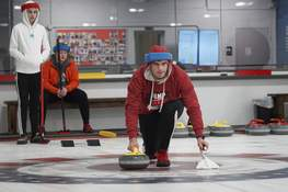 Mike Moore | The Journal Gazette Concordia Lutheran High School senior Elijah Zillman slides a curling stone  this month at the Fort Wayne Curling Club on Wells Street. Curling burns an average of 356 calories an hour for a man and 304 for a woman.