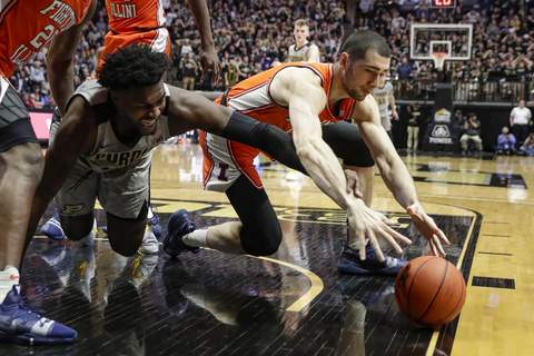 Illinois Purdue Basketball Purdue forward Trevion Williams (50) and Illinois forward Giorgi Bezhanishvili (15) go for a loose ball during the second half of an NCAA college basketball game in West Lafayette, Ind., Tuesday, Jan. 21, 2020. Illinois defeated Purdue 79-62. (AP Photo/Michael Conroy) (Michael Conroy STF)