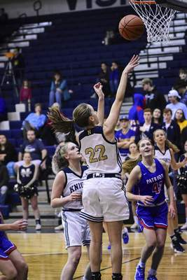 Mike Moore | The Journal Gazette Norwell junior Maiah Shelton scores under the basket in the first quarter against Jay County at Norwell High School on Tuesday.