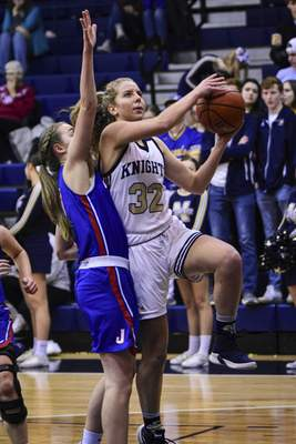 Mike Moore | The Journal Gazette Norwell senior Breann Barger drives to the basket in the first quarter against Jay County at Norwell High School on Tuesday.