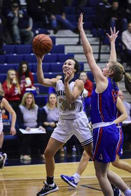 Mike Moore | The Journal Gazette Norwell junior Lauren Bales drives to the basket in the first quarter against Jay County at Norwell High School on Tuesday.
