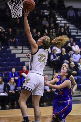 Mike Moore | The Journal Gazette Norwell senior Breann Barger scores under the basket in the first quarter against Jay County at Norwell High School on Tuesday.
