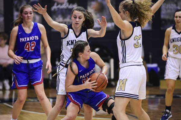 Mike Moore | The Journal Gazette Norwell defenders Maiah Shelton, left and Breann Barger put pressure on Jay County guard Izzy Rodgers in the second quarter at Norwell High School on Tuesday.