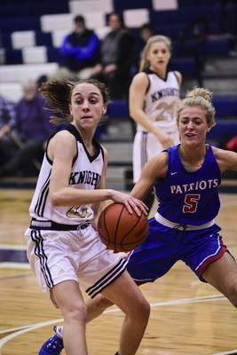 Mike Moore | The Journal Gazette Norwell junior Maiah Shelton looks to pass the ball in the first quarter against Jay County at Norwell High School on Tuesday.
