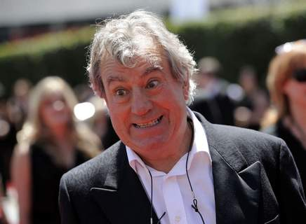 In this Saturday, Aug. 21, 2010 file photo, Terry Jones arrives at the Creative Arts Emmy Awards in Los Angeles. (AP Photo/Chris Pizzello, file)