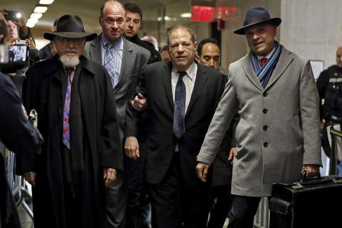 Sexual Misconduct Weinstein Harvey Weinstein, center, accompanied by attorney Arthur Aidala, right, arrives at court for his rape trial, in New York, Wednesday, Jan. 22, 2020. (AP Photo/Richard Drew) (Richard Drew STF)
