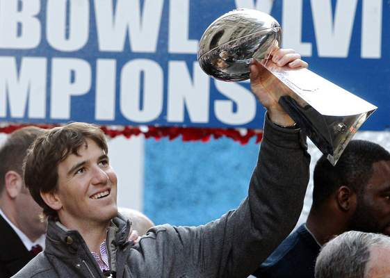Associated Press Giants quarterback Eli Manning holds up the Vince Lombardi Trophy during the team's parade in 2012. Manning has decided to retire from the NFL after 16 seasons.