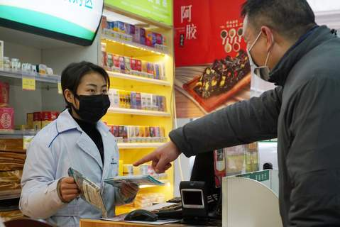 China Outbreak Associated Press A shopper asks a clerk about masks Wednesdayat a pharmacy in Wuhan, China, amid  worries over an outbreak of a new coronavirus. (Dake KangSTF)