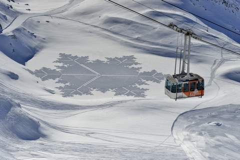 Snow Art Simon Beck Snow Art  A gondola passes one of Simon Beck's pieces in the snow at the Les Arcs ski resort in southeastern France. The 61-year-old British artist and a handful of volunteers recently created this design near Silverthorne, Colo. (Simon BeckHONS)