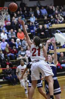 Mike Moore | The Journal Gazette Bishop Luers guard Lydia Reimbold scores under the basket while being fouled by Bishop Dwenger senior Brianna Yager in the third quarter at Bishop Luers High School on Friday.  (The_Journal_Gazette)