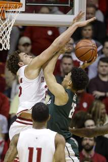 Michigan St Indiana Basketball Indiana forward Race Thompson (25) blocks the shot of Michigan State forward Malik Hall (25) in the first half of Indiana's 67-63 win over the No. 11 Spartans on Thursday. Thompson left the game in the first half with a lower-back injury after taking a hard fall and did not return. Coach Archie Miller said he hopes the injury is only