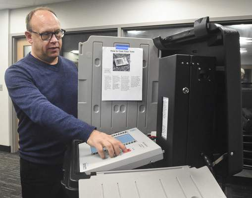 Michelle Davies | The Journal Gazette Steve Shamo, with MicroVote, explains how a new voting machine meets the requirement for Indiana voting machines to have VVPATS (Voter Verifiable Paper Audit Trails).