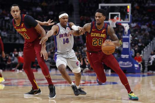 Cavaliers Pistons Basketball Cleveland Cavaliers forward Alfonzo McKinnie (28) drives as Detroit Pistons forward Louis King (14) defends during the first half of an NBA basketball game, Monday, Jan. 27, 2020, in Detroit. (AP Photo/Carlos Osorio) (Carlos Osorio
