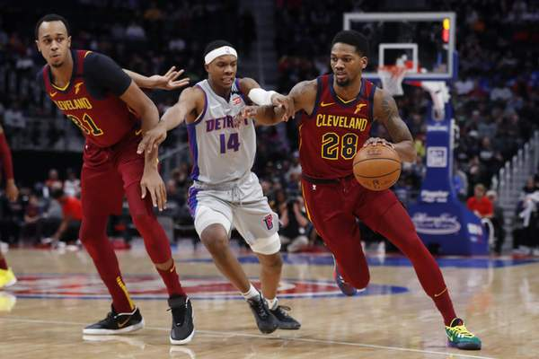 Cleveland Cavaliers forward Alfonzo McKinnie (28) drives as Detroit Pistons forward Louis King (14) defends during the first half of an NBA basketball game, Monday, Jan. 27, 2020, in Detroit. (AP Photo/Carlos Osorio)