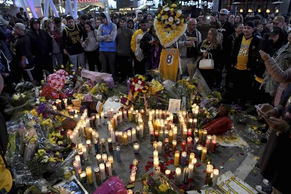 Associated Press Photos  People gather at a memorial near Staples Center after the death of Laker legend Kobe Bryant Sunday, in Los Angeles.