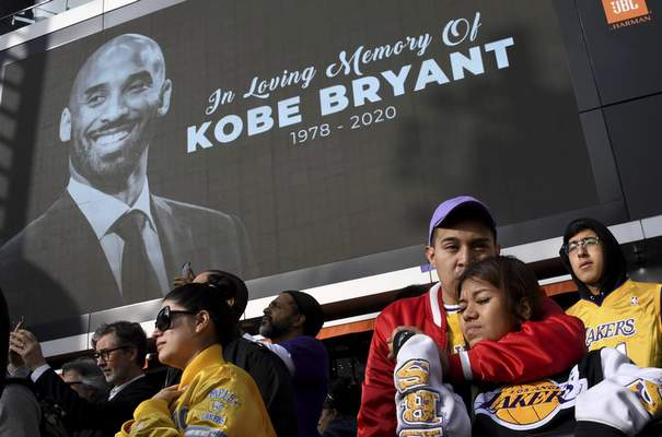 Associated Press  Fans mourn the loss of Kobe Bryant in front of La Live across from Staples Center, home of the Los Angeles Lakers in Los Angeles on Sunday. Bryant, the 18-time NBA All-Star who won five championships and became one of the greatest basketball players of his generation during a 20-year career with the Los Angeles Lakers, died in a helicopter crash Sunday.