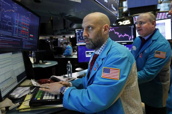 Specialist Meric Greenbaum, left, works on the floor of the New York Stock Exchange, Monday, Jan. 27, 2020. Stock tumbled at the open on Wall Street following a sell-off in markets in Europe and Japan as investors grow more concerned about the potential economic impact of an outbreak of a deadly coronavirus. (AP Photo/Richard Drew)