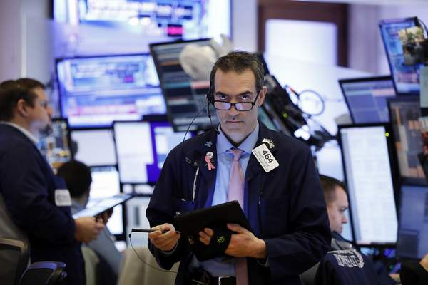 Trader Gregory Rowe works on the floor of the New York Stock Exchange, Monday, Jan. 27, 2020. Stock tumbled at the open on Wall Street following a sell-off in markets in Europe and Japan as investors grow more concerned about the potential economic impact of an outbreak of a deadly coronavirus. (AP Photo/Richard Drew)