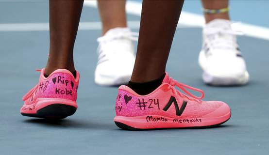 APTOPIX Australian Open Tennis United States' Coco Gauff, front, and compatriot Caty McNally wear a tribute to Kobe Bryant on their shoes during their doubles match against Japan's Shuko Aoyama amd Ena Shibahara at the Australian Open tennis championship in Melbourne, Australia, Monday, Jan. 27, 2020. (AP Photo/Dita Alangkara) (Dita Alangkara