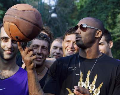 Kobe Bryant Italy Basketball FILE - In this Sept. 28, 2011, file photo, U.S. basketball star Kobe Bryant plays with a ball during a sponsor's appearance in Milan, Italy. (AP Photo/Luca Bruno, File) (Luca Bruno STF)