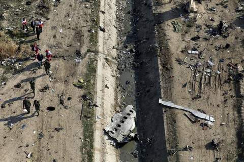 Iran Plane Crash Wider Woes FILE - In this Jan. 8, 2020, file photo, rescue workers search the scene where a Ukrainian plane crashed in Shahedshahr, southwest of Tehran, Iran. (AP Photo/Ebrahim Noroozi, File) (Ebrahim Noroozi STF)