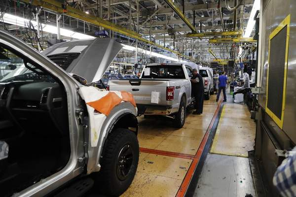 FILE - In this Sept. 27, 2018, file photo a United Auto Workers assemblyman works on a 2018 Ford F-150 truck being assembled at the Ford Rouge assembly plant in Dearborn, Mich. (AP Photo/Carlos Osorio, File)