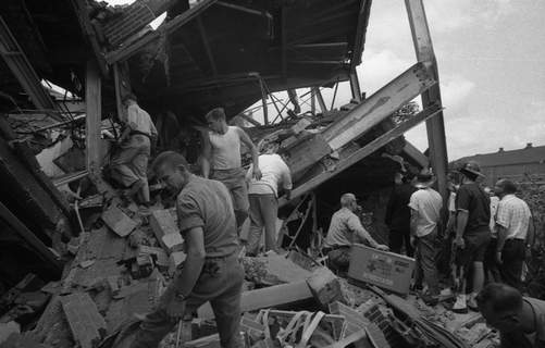 Rescue workers search among the rubble at the administration office of Phelps Dodge Copper Products Corp. on Aug. 23, 1966.