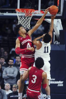 Associated Press Indiana's Trayce Jackson-Davis, left, and Justin Smith, forefront,  will have to do a good job of defending on the interior against Ohio State forward Kaleb Wesson today.