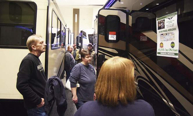 Katie Fyfe   The Journal Gazette  Visitors browse through a selection of RVs and campers at the Fort Wayne RV & Camping Show on Saturday at Memorial Coliseum.