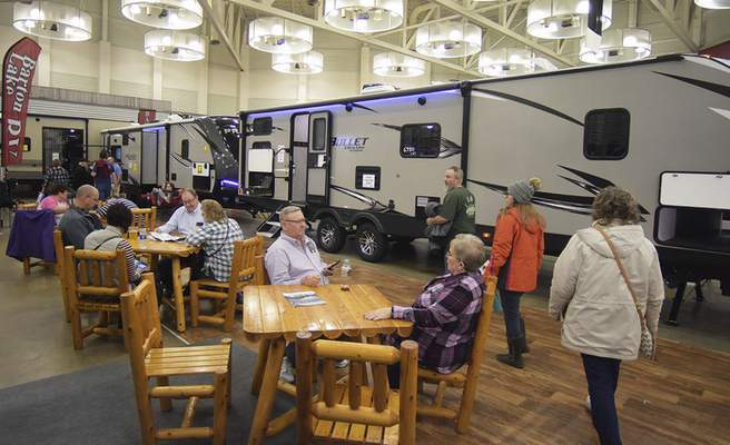 Katie Fyfe   The Journal Gazette Visitors browse through a selection of RVs and campers at the Fort Wayne RV & Camping Show on Saturday.