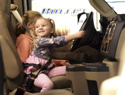 Katie Fyfe   The Journal Gazette Evelyn Wedler, 4, takes the wheel while sitting in an RV with her sister Addison, 7, during the Fort Wayne RV & Camping Show on Saturday.