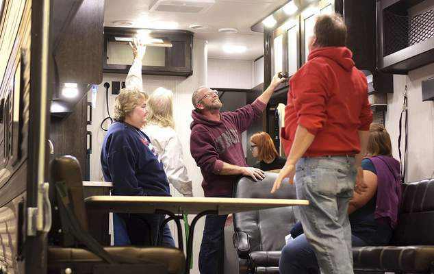 Katie Fyfe   The Journal Gazette  Brian Lee, center, looks at the inside of an RV during the Fort Wayne RV & Camping Show at the Allen County War Memorial Coliseum on Saturday.