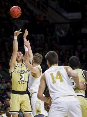 Georgia Tech's Evan Cole (3) shoots over Notre Dame's Rex Pflueger during the first half of an NCAA college basketball game Saturday, Feb. 1, 2020, in South Bend, Ind. Notre Dame won 72-80. (AP Photo/Robert Franklin)