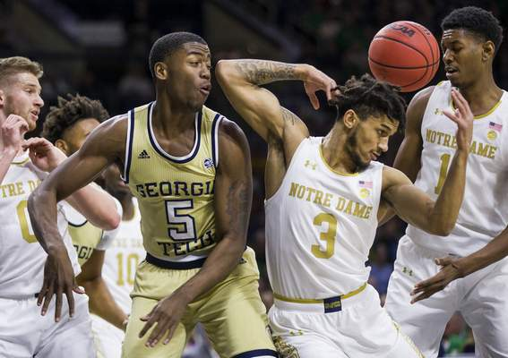 Notre Dame's Prentiss Hubb (3) and Georgia Tech's Moses Wright (5) compete for a rebound during the first half of an NCAA college basketball game Saturday, Feb. 1, 2020, in South Bend, Ind. (AP Photo/Robert Franklin)