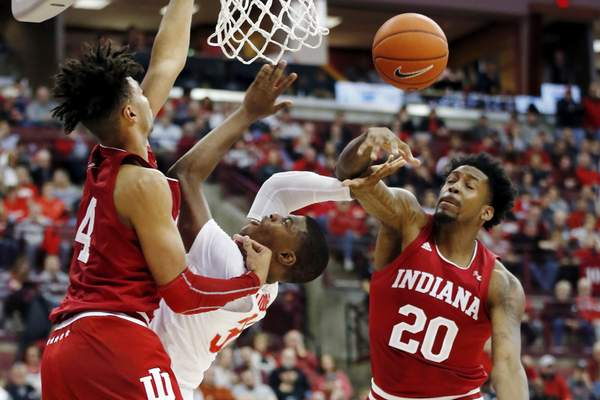 Associated Press Indiana's De'Ron Davis, right, fouls Ohio State's E.J. Liddell as Trayce Jackson-Davis defends during the second half Saturday in Columbus.