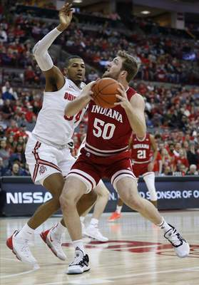 Indiana's Joey Brunk tries to shoot over Ohio State's Kaleb Wesson duringthe Buckeyes' 68-59 win on Saturday. The Hoosiers have lost three games in a row for the first time this season.(AP Photo/Jay LaPrete)