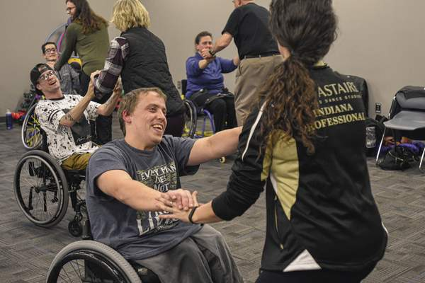 Photos by Mike Moore | The Journal Gazette Matt Kwapis practices the cha-cha with Carmen Schlatter, director of the Fred Astaire Dance Studios during an adaptive ballroom dance class at Turnstone.