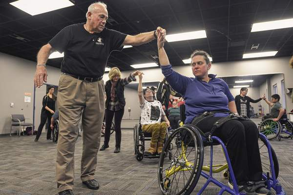 Katie Hoffman and David Sholl do the cha-cha at Turnstone. Hoffman has wanted to dance her entire life, and the adaptive ballroom class is giving her the opportunity to fulfill that dream.
