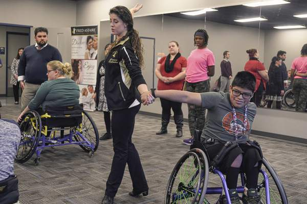 Mike Moore | The Journal Gazette  Cole Connelley practices the Cha Cha dance with Fred Astaire Dance Studios dance director Carmen Schlatter during an adaptive ballroom dance class at Turnstone on Tuesday 01.21.20