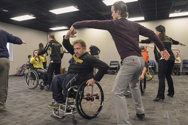 Mike Moore | The Journal Gazette  Kevin Hughes practices the Cha Cha dance with Fred Astaire Dance Studios specialist instructor Joseph Smith during an adaptive ballroom dance class at Turnstone on Tuesday 01.21.20